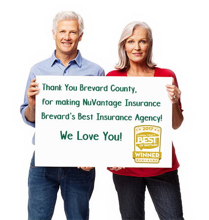 NuVantage-Insurance-couple-holding-sign